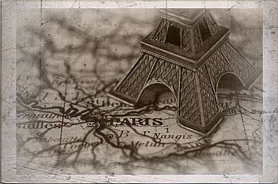 scratched photo of eiffel tower on map with paris