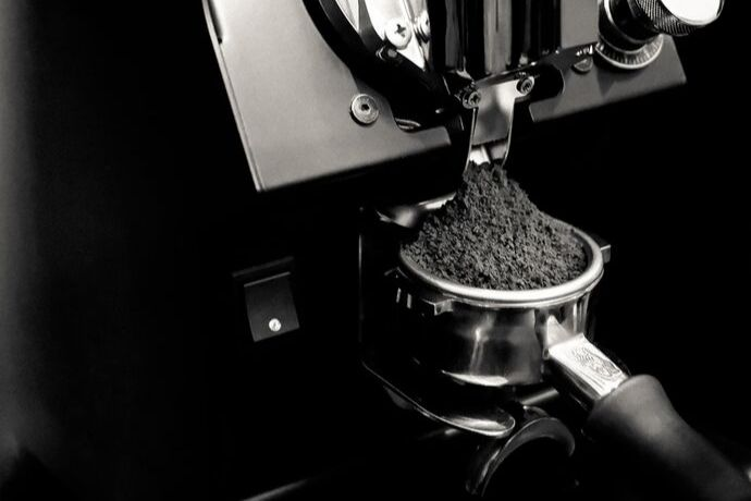 coffee grounds coming out from one of the best espresso grinders