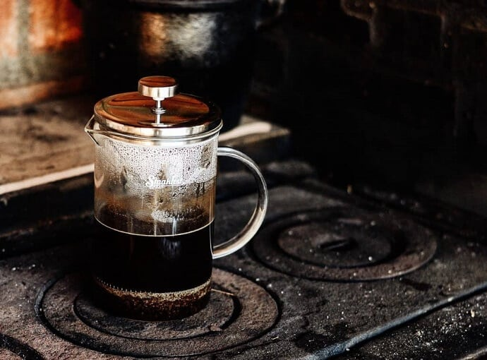 a french press half full with coffee