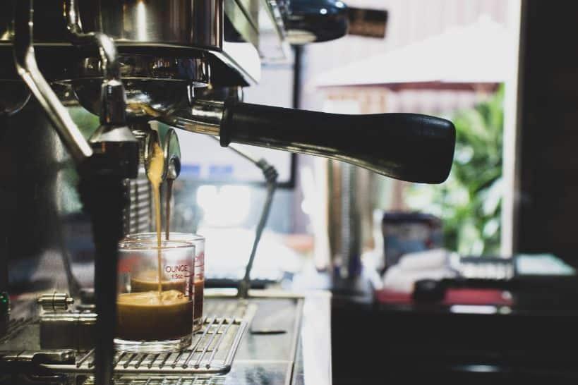 a semi auto type of espresso machine in front of window